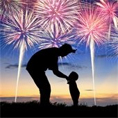 man and child watching fireworks